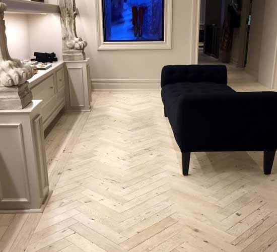 Antique Oak Flooring in Herringbone with custom whitewashed finish