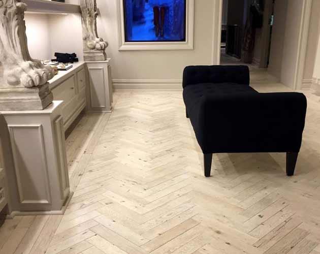 Antique Oak Flooring in Herringbone with custom whitewashed finish