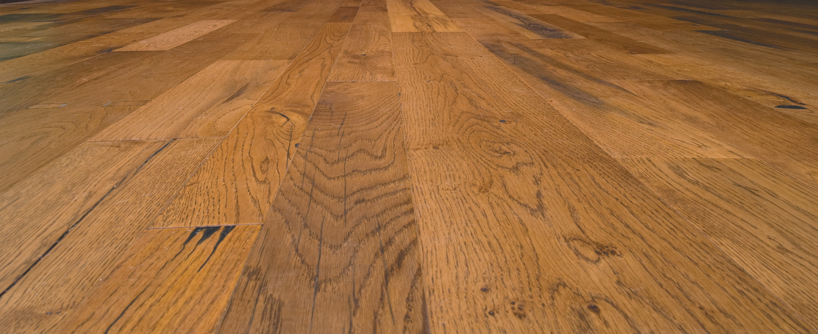 antique oak flooring with a rich patina from stout beer from the original Guinness brewery